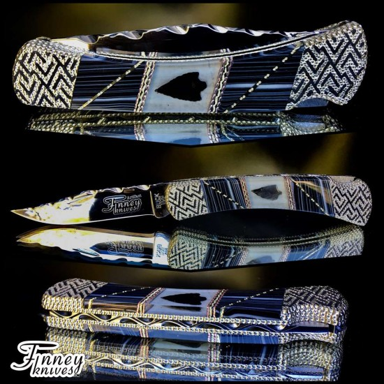 Buck 110 with genuine antique native American Indian arrowheads inlaid with banded black and white Prototype