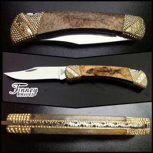 Custom Buck 110 with real fossil fish in its 50 million year old Matrix