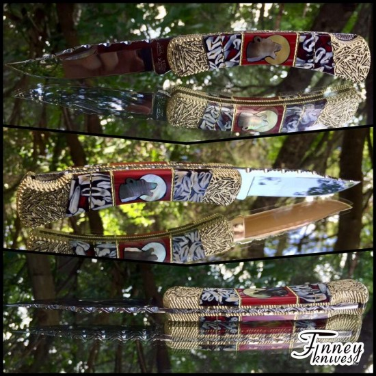Custom Buck 110 with Genuine Coyote Teeth inlaid with Mother of Pearl Wolf on Red Spiney Oyster