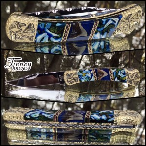 Custom Buck 110 with Genuine Modern Day and Fossil Shark Teeth cast in blue with gold highlights Prototype
