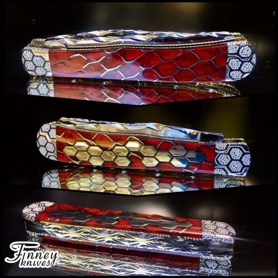 Case xx Trapper with aluminum and silver honey comb inlay in red