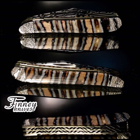 Case xx Peanut with genuine woolly mammoth tooth engraved bolsters run of 2