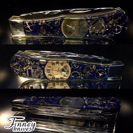 Remington 2012 - 30th anniversary Jumbo Trapper R1123 Bullet Knife Steampunk Navy Blue Background