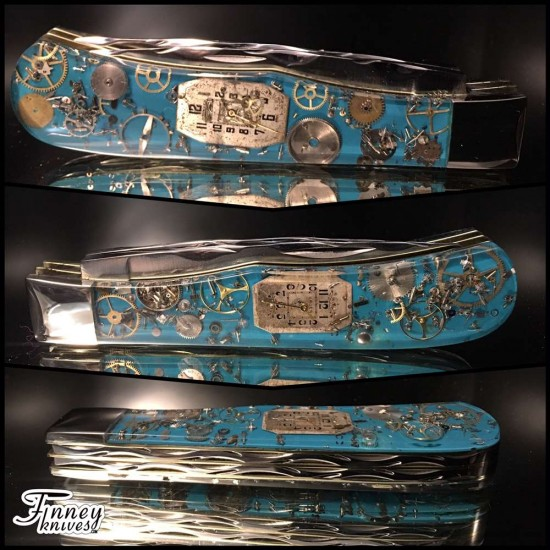 Remington 2012 - 30th anniversary Jumbo Trapper R1123 Bullet Knife Steampunk Turquoise Background
